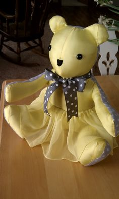 Keepsake teddy bear I made out of the bridesmaid dresses from my son and daughter-in-law's wedding as they are expecting their first baby.