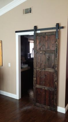 Custom Spanish Style sliding barn door with clavos. Located in San Diego!