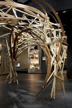 L'Eclaireur [Paris] : Arne Quinze : retail design.  Bizarre wood structure thing. Gives the feeling of forest, tunnel, abandoned house...
