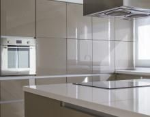 Rehau has branched into a new segment following the launch of its Rauvisio line of surface material.Well known mostly as an edgebanding material supplier, to produce its exacting new lines of high gloss Rauvisio cabinetry and panel surfaces, Rehau has taken on an added role of door and drawer component supplier.