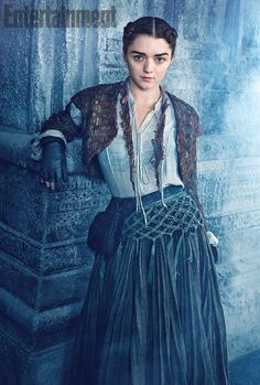 You'll hardly recognize Arya in Game of Thrones this year -- no more muddy brown tunic and boy-ish haircut! Now that the fan-favorite character has escaped Westeros, where she was traveling incognito disguised as a peasant boy for the past several seasons, the deadly Stark daughter received a radical makeover for her new life in Braavos.: