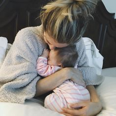 """""""Morning snuggles with my girl. First time I've been able to hold her by myself in a week. #GirlsTrip #LA"""""""