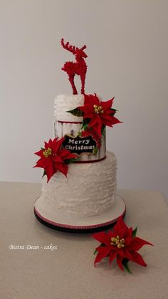 Christmas cake with poinsettias and a reindeer ...  by Bistra Dean