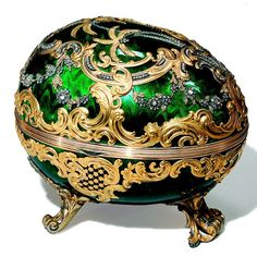 The Rocaille Egg by Fabergé. 1902, commissioned by Mme. Barbara Kelch. Kelch had vast mining interests in Siberia and was one of Fabergé's wealthiest and best customers.  This egg features brilliant green guilloché enamel, with gold scrollwork, diamond-set floral swags, and diamond-set palm trees.  By Fabergé, workmaster Michael Perchin.