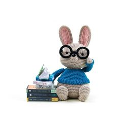"""No matter if its rainy snowy or sunny outside Norman will happily stay indoors with his books. Every volume hides a new world full of adventures and mysteries. While slowly sinking into his comfy chair Normans vivid imagination will take him along the most wonderful places in times both far ago and far ahead. Norman is part of the new book """"Amigurumi Globetrotters"""" by @airali_gray! Pre-sale will start this weekend! >>Follow the link in profile to subscribe and be the first to know about…"""