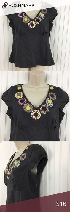 """Boden cotton embellished top Gray Boden cotton top. V-neck Embellished with fabric circles around the neckline. Hidden side zipper. Empire waist. The is a small amount of damage to the thread and fabric just above the zipper( see the pics) other this shirt is in good condition. Approximate measurements flat across: Chest: 19"""" Waist: 16.5"""" Length: 22 """" Boden Tops Blouses"""