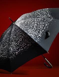 A distinctive umbrella in abstract animal print from Burberry for A/W13