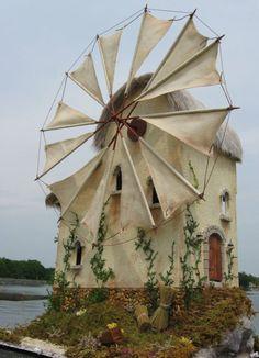 tiny windmill looks like an American version of a Dutch Windmill.