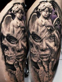 Face, skull, angel statue tattoo. Awesome detail.