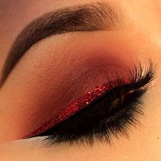 Gorgeous party eye makeup with fire red metallic eyeliner above the top lashes