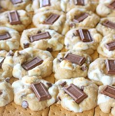 S'mores Cookies     Ingredients:   11 Tablespoons unsalted butter, softened   1 cup brown sugar, packed   ½ cup granulated sugar   2 large eggs   1 teaspoon vanilla   1 teaspoon baking soda   ½ teaspoon sea salt   1 teaspoon cinnamon   2 ½ cups flour   1/2 cup semi-sweet chocolate chips   1 cup mini marshmallows   3 regular sized Hershey's bars, broken into pieces (I like Hershey's Symphony bars—the chocolate is incredibly creamy!)   1-2 packages graham crackers, broken into squares…