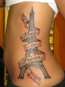 eiffel tower tattoo with a banner sort of like that, different quote