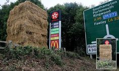 Farmer blocks McDonald's sign with hay bales in fast food feud