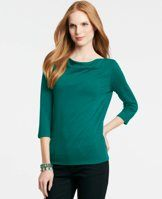 Knit Draped Boatneck Top - Our favorite wear-now silhouette reveals a high boatneck with a subtle drape, made from a luxe sweater inspired knit. Draped boatneck. 3/4 sleeves.