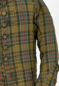 Detail: Man's coat, Woollen, twill-weave hard tartan, Scottish, 1740–50. Carefully cut so the pattern lines up when sewn together. Said to have been worn by a rider in Bonnie Prince Charlie's army at the Battle of Culloden in 1746. This tartan pattern, or sett, is still available today as 1328 Culloden (District) tartan. © CSG CIC