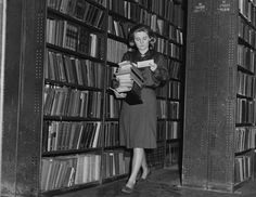 A librarian at the British Library of Political and Economic Science collecting books for readers in the reserve stacks, 1964.