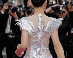 Phoenix inspired gown. Chen Tingjia arrives on the red carpet at Cannes 2012 for the screeing of the film De rouille et d'os. (back)