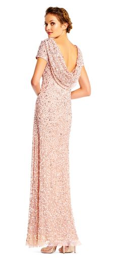 Go for plenty of shine in this all new silhouette. Featuring our signature crunchy sequin beading, short sleeves, and a draped cowl back, this formal dress is unparalleled. A modified skirt gives this dress a mermaid-esque silhouette. Paired with matching heels, this gown is ready for every formal event. We love this beaded gown for bridal parties and galas.