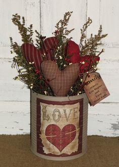 I have added a grungy ivory finish to this tin and then filled it with three of my handmade primitive hearts, dried floral and berries. I have added a nice primitive Valentine Love graphic to the front of the tin. Will make a nice shelf sitter décor for your Valentine and everyday home décor. I have added a grungy tag to the side of the arrangement with the saying FAMILY Where Life Begins and Love Never Ends. Measures approx 10 x 15-16 Ready to ship in 2-3 days