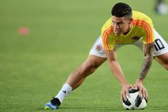 Colombia national football team's forward James Rodriguez warms up before the international friendly football match between Egypt and Colombia at...
