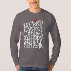 """A fun modern Xmas holidays greeting card done in a fancy typography style and reading """"Merry Christmas & Happy New Year; topped with a cute red Santa hat. Ideal to wear to a Christmas party or to give as a novelty gift."""