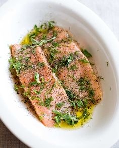 This delicious and easy Greek Salmon is the perfect quick healthy dinner for the whole family. The marinade is a simple mix of olive oil, lemon, dill, and oregano. The fish is pan-fried, giving it a wonderfully crisp exterior and meltingly tender and succulent center. Perfect for serving with orzo and a Greek salad. Transport your self to Greece with the traditional and authentic recipe for Greek Salmon! Delicious Salmon Recipes, Grilled Salmon Recipes, Best Seafood Recipes, Fish Recipes, Healthy Recipes, Greek Salmon Recipe, Cooking Salmon Fillet, Lemon Dill Salmon, Fish Marinade