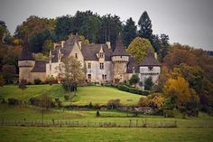 Chateau with turrents. La Grande Filolie in Dordonge, France. Photo by Frédéric L / Boccalupo, via Flickr