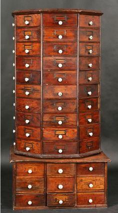Antique revolving multi drawer hardware cabinet.