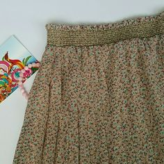 🌌Buy 3 Get 1 Free🌌Floral Pleated Skirt Blush pink background with yellow, turquoise, and pink dainty flowers. shiny gold detailing on elastic waistband fully lined 100% polyester Fire Los Angeles Skirts
