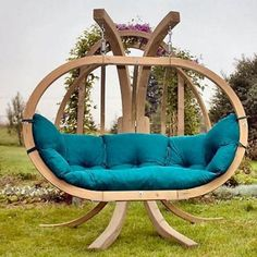 Amazing Wooden Swing in a Unique Garden
