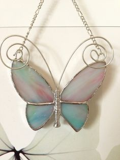 Stained glass butterfly pink and blue Stained Glass Ornaments, Stained Glass Suncatchers, Stained Glass Crafts, Stained Glass Patterns, Glass Printing, Glass Butterfly, George Strait, Beveled Glass, Glass Design