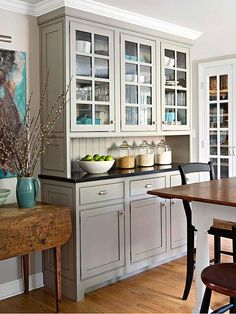 small grey kitchen | glass door cabinets