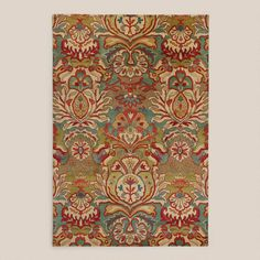 One of my favorite discoveries at WorldMarket.com: Floral Medallion Tufted Wool Rug marries the color of my grand room and my family room. Perfect!