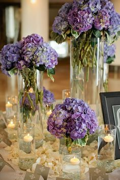 purple hydrangea centerpieces combined with candles and flower petals / http://www.deerpearlflowers.com/purple-hydrangeas-wedding-flower-ideas/
