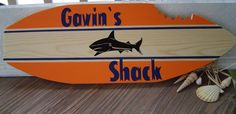 SALE 27 inch SHaRK SURFBOARD Wall art Beach Name Sign .PERSONALIZED Hawaiian Surf Wall Decor. Navy / Orange 150 Designs 3 sizes. wow via Etsy