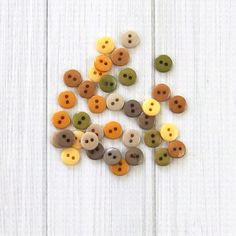 Tiny round buttons in 6 natural colors. Each package contains 36 buttons. Suggested uses: Doll clothes, hair clips and headbands, button bracelets, earrings, ma Round Button, Stud Earrings, Buttons, Trending Outfits, Unique Jewelry, Handmade Gifts, Crafts, Etsy, Vintage