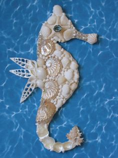 https://www.etsy.com/listing/192320338/seahorse-wall-decor-seahorse-shell-art?ref=shop_home_active_1
