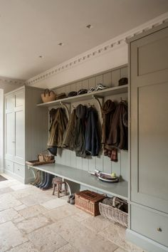A bootroom/mudroom designed for an English country house by Artichoke.
