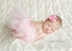 Would love to have newborn pics done like this. :)
