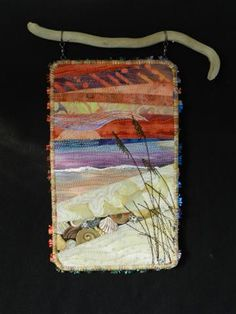 Tranquility.  Small art quilt beach scene hanging from found driftwood.