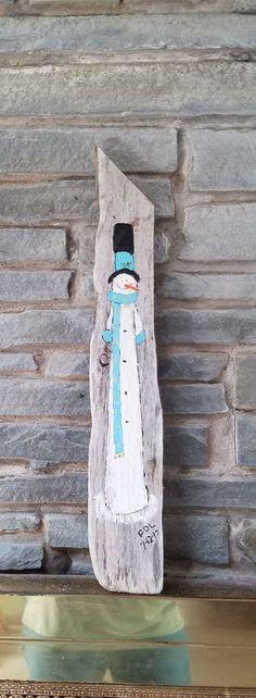 Snowman on driftwood