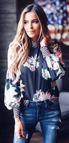woman wearing black and blue floral long-sleeved top and distress blue denim skinny jeans. #SpringOutfits #SpringDress #outfit2018 #Spring #Outfit #women #dressescasualspring