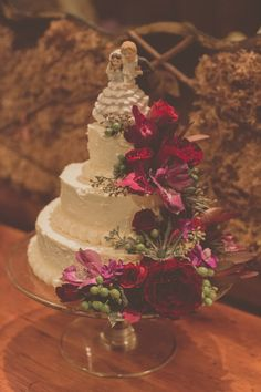 traditional wedding cake with fuchsia flowers // photo by Tree of Life Films