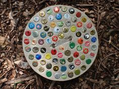 And one with the caps inverted to scrape mud off shoes after gardening! // bottle cap stepping stone | Bottle cap stepping stone from https://www.facebook.com/pages/Blue ...
