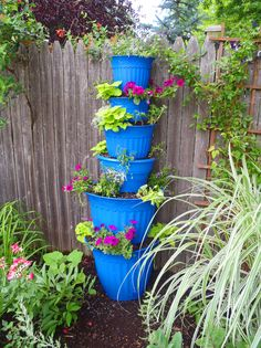 maybe my next tower along the fence...love the idea of painting the pots...why not mix the colors for a more vibrant effect....