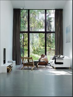 Just Gorgeous. I want that window, the woods outside, the space, the floors, the furiture. E v e r y t h i n g.
