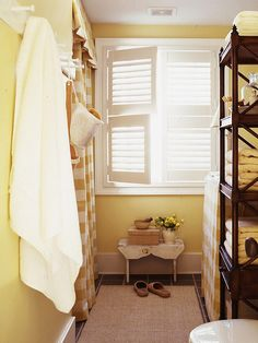 Replace window treatments with crisp white shutters for a casual cottage feel. Vinyl shutters cost less than wood ones and stand up to the humidity of a bathroom without warping. -- Love this!