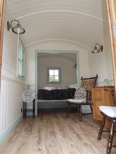 Bryn Dowsi Shepherd's Hut, Bryn Dowsi Organic Farm, Gwynedd. Our two berth shepherd's hut offers a step above camping. With heating, electricity and a comfortable bed it is ideal for 'glamping'