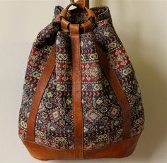 90s Tapestry Bucket Bag, hipster drawstring backpack, chestnut brown leather & woven tribal fabric slouchy boho hippie grunge book satchel. $128.00, via Etsy.