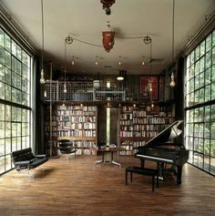 I like this library with the piano and walls of windows